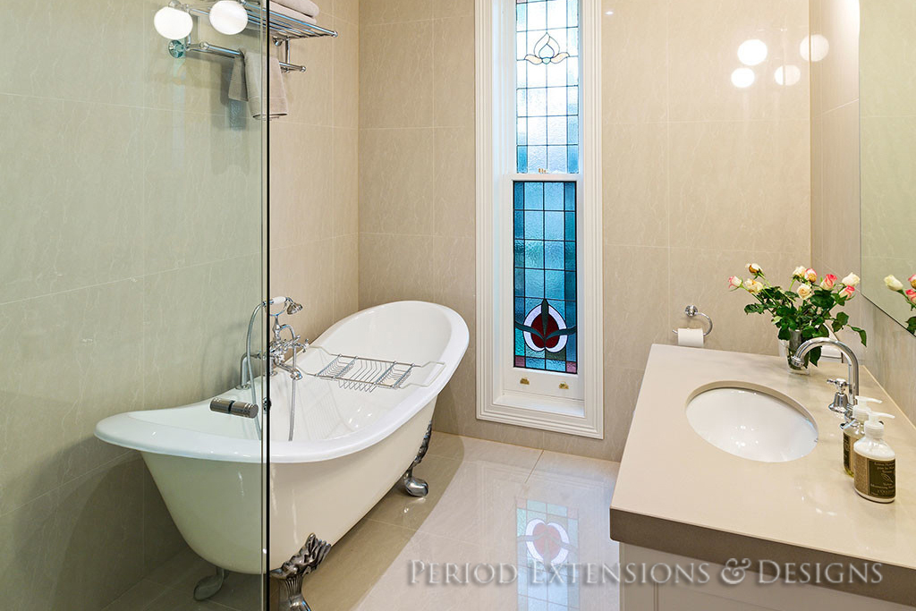 bathroom with a bathtub and wash basin
