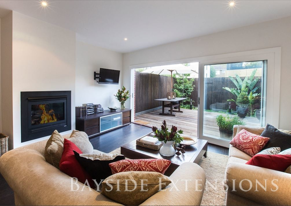 modern living area with a gas fireplace