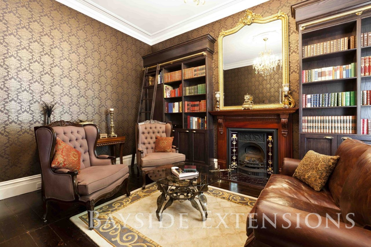 Victorian era style living area with a fireplace