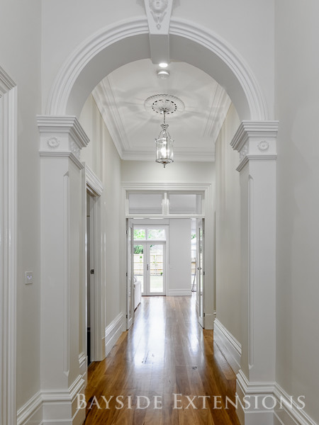 long hallway with white walls