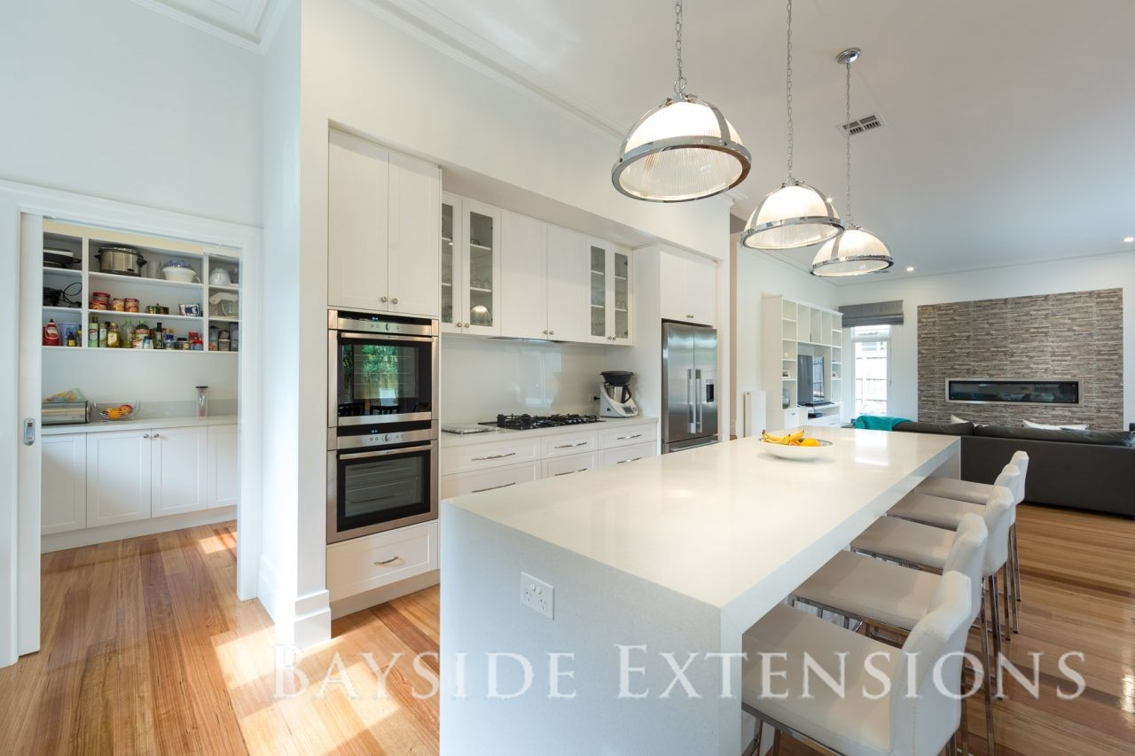 large white kitchen and dining area