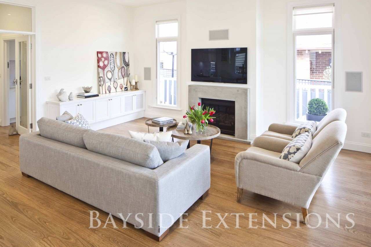 living area with white walls and fireplace