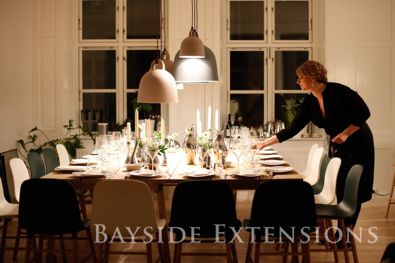 woman preparing a dinner table