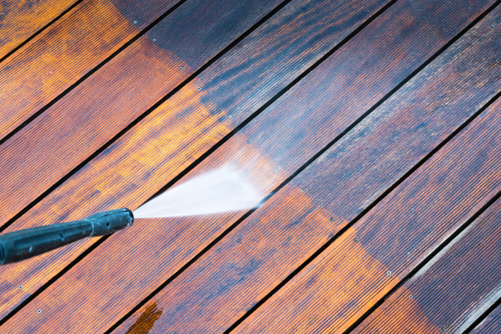 cleaning a deck using power hose